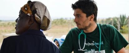 Projects Abroad male intern waits to examine patients at a medical outreach in Kenya.